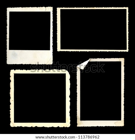 Old vintage photo frames on black background - stock photo