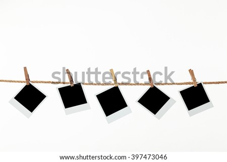 Old Vintage Photo Frames Scanned from Original Old photos. black photo paper. Hanging on a clothesline with clothespins. On white background