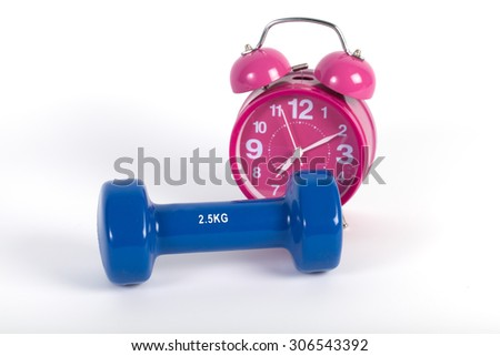 Old Vintage Pink alarm-clock and dumbbells isolated on white - stock photo