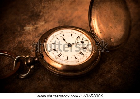Old vintage pocket watch.Selective focus in the middle of watch