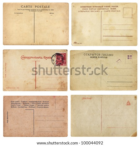 Old Vintage Postcards. Set of aged vintage postcards from early 1900. Comes on white background, isolated with clipping path. - stock photo