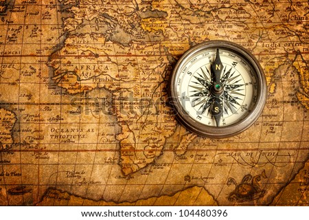 Old vintage retro compass on ancient map. The map used for background is in Public domain. Map source: Library of Congress. Country: Belgium Year: 1570. Author: Abraham Ortelius (1527-1598) - stock photo