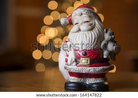 Old vintage Santa and Christmas tree lights - stock photo