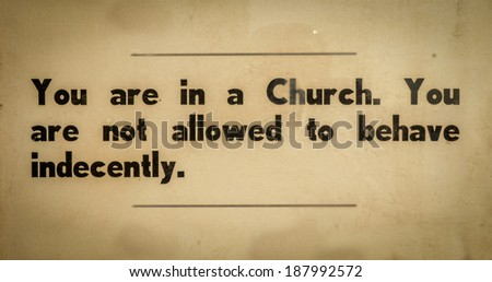Old VIntage Sign In A Church Asking Visitors To Behave Respectfully - stock photo
