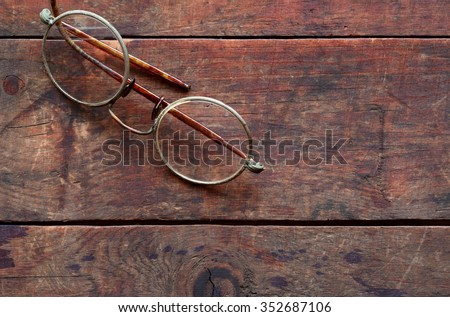Old vintage spectacles on nice wooden background - stock photo
