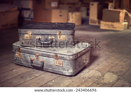 Old vintage suitcases in a dusty attic