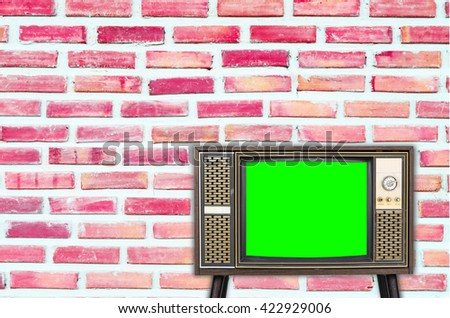 Old vintage television on color background - stock photo