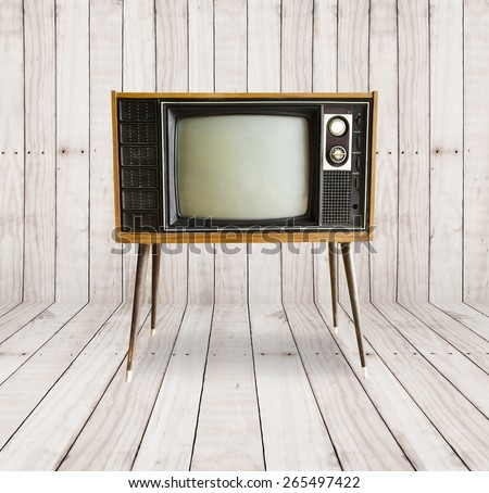 old vintage television on wood background. - stock photo