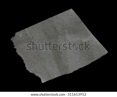 Old vintage torn creased paper isolated on black. - stock photo