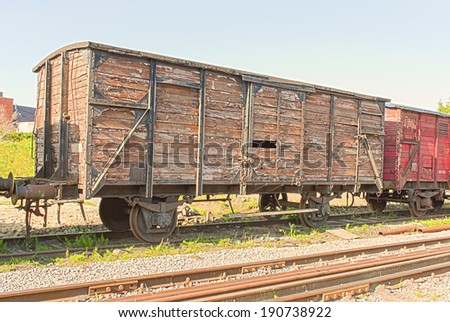 old vintage  train wagon on the rails - stock photo