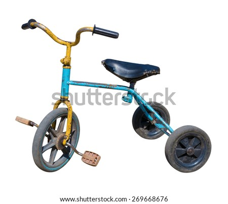 old vintage tricycle children bicycle. Isolated over white background - stock photo
