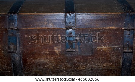 Old vintage trunk of wood with iron.