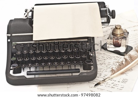 old vintage typewriter,feather,inkwell and letter - stock photo