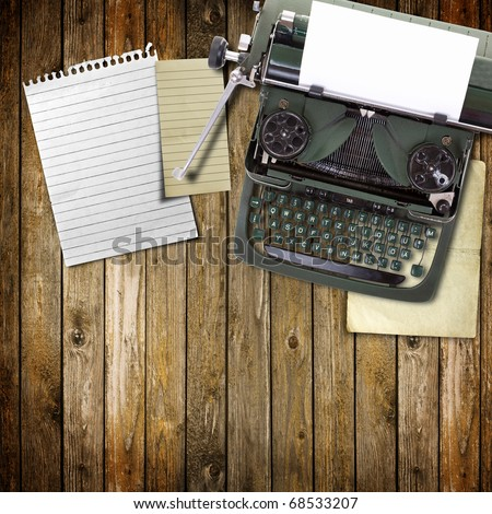 Old vintage typewriter with a blank sheet of paper inserted in wood background - stock photo