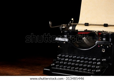 Old vintage typewriter with blank paper - stock photo