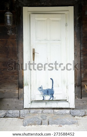 Old vintage white door - stock photo