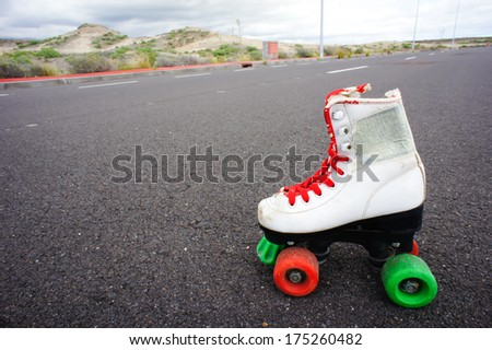 Old Vintage White Skate Boot on the Asphalt Sterret - stock photo