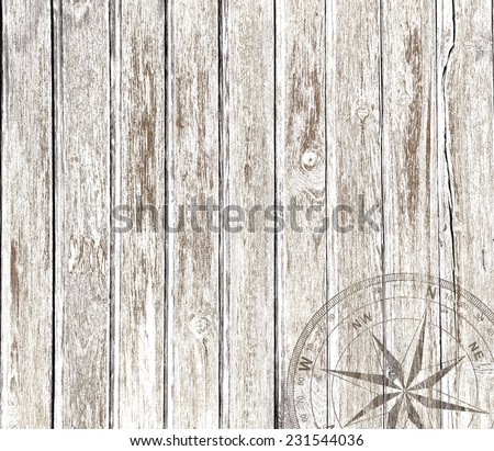 Old vintage wood background with compass - stock photo