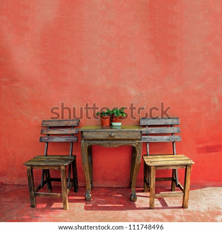 old vintage wooden chair and table - stock photo