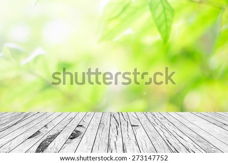 old vintage wooden desk table with blurred nature backgrounds,put and show your products on this backgrounds - stock photo