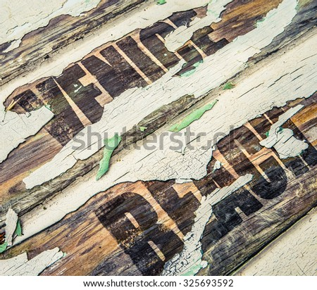 Old Vintage Wooden Sign For Venice Beach, California With Peeling Paint - stock photo