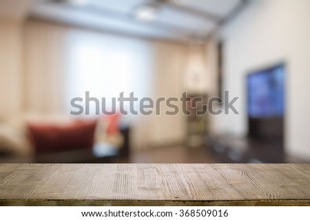 old vintage wooden table in the living room - stock photo