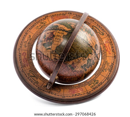 Old vintage wooden terrestrial world globe showing the maps of the continents and oceans for travel, geography and navigation lying at an oblique angle over white - stock photo