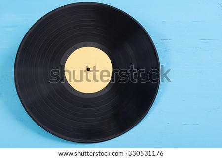 old vinyl record on a blue background