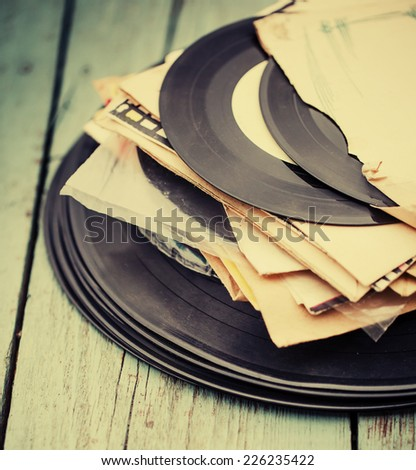 old vinyl record on rusty vintage background - stock photo