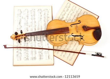 Old viola, bow, and vintage music sheet - stock photo