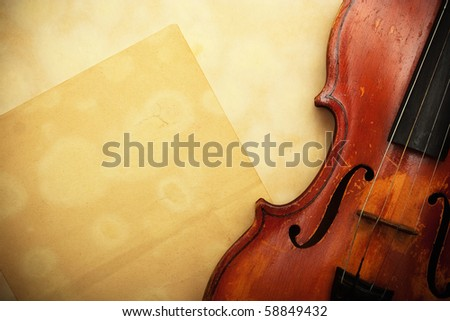 old violin and empty yellow paper - stock photo