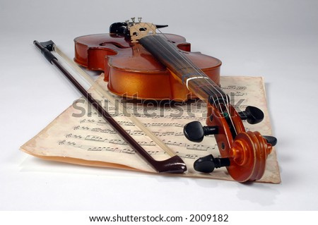 Old violin and vintage music sheet make an elegant still life. - stock photo