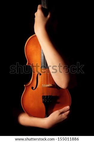 Old violin in woman hands - stock photo