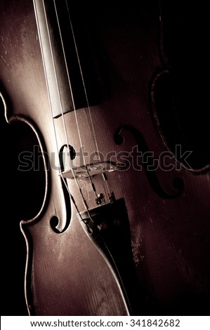 Old violin isolated on black background. - stock photo