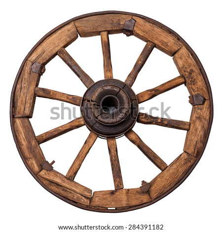 old wagon wheel on a white background - stock photo