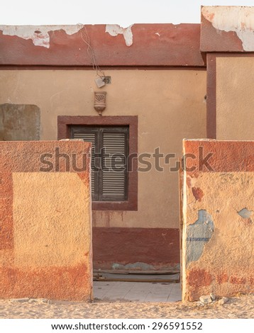 old wall and house - stock photo