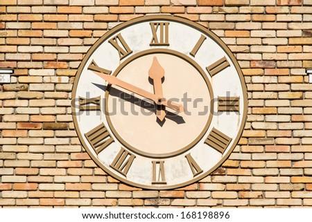 Old wall clock at a church - stock photo