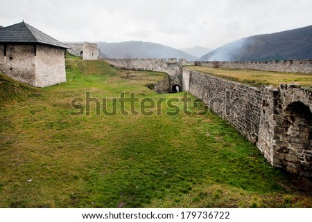 Old wall, exit and ancient powder tower built in 14th century inside the stone fort in the Balkan mountains near the city Jajce, Bosnia and Herzegovina.  - stock photo