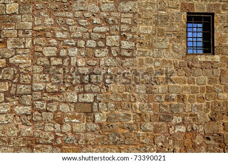 Old wall from the Jerusalem stone and window with lattice - stock photo