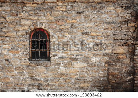 Old wall from the Jerusalem stone and window with lattice window - stock photo