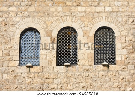 Old wall made from Jerusalem stone with  windows - stock photo
