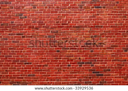 Old wall of red briks tiled background, regular block texture. Old wall of red briks. Red brick wall. Wallpaper of ordinary building wall texture. Tiles. Background of brick wall texture. - stock photo