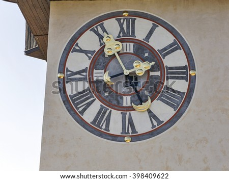 old wall outdoor clock with window on tower Uhrturm closeup. Schlossberg fortress in Graz, Austria