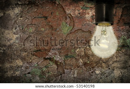 Old wall with an electric lamp - stock photo
