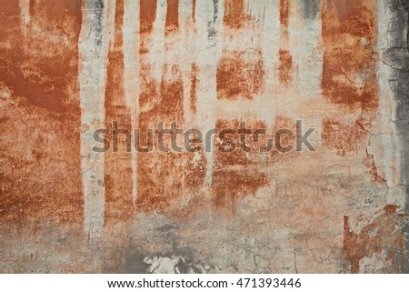 old wall with orange brown stained plaster - grunge paint abstract background texture
