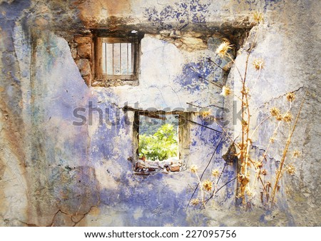 Old wall with Windows - Gairo Vechio, Sardinia, Italy - village devastated by a flood - vintage styled Picture with patina texture - stock photo