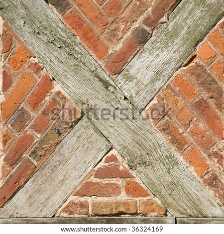 old wall with x-shaped beams - stock photo