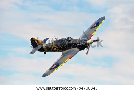 OLD WARDEN, UK - AUGUST 7: The last UK example of a Hawker Sea Hurricane,Z7015, gives a low level aerial display at the Shuttleworth summer air gala on August 7, 2011 in Old Warden. - stock photo