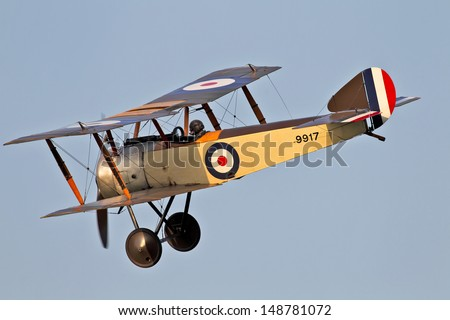 OLD WARDEN, UK - JULY 6: A Sopwith pup warms up on the outer edge of the airfield before giving an air display to the waiting crowds on July 6, 2013 in Old Warden