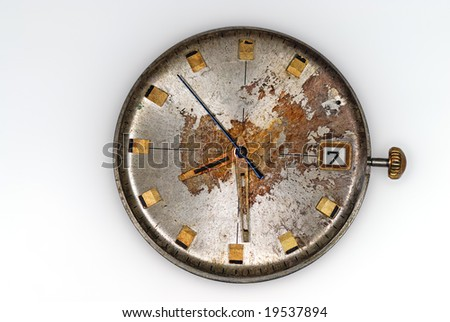 Old Watch, dial is covered by a rust and scratched - stock photo